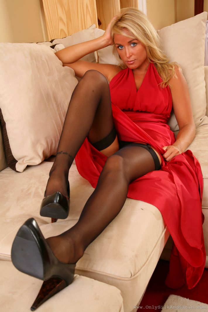 http://pics.sexybabegirls.com/only-silk-satin/stunning-blonde-teases-you-out-of-her-red-evening-dress/rosie-w-04.jpg